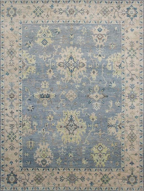 Traditional hand-knotted area rug with blue field and taupe border.