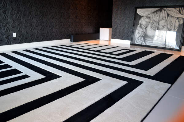 View of custom fabricated rug in black and white