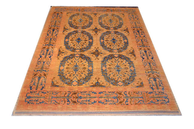 Hand-knotted wool rug in amber/blue