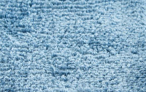 Hand loomed carpet with heavy pile in blue.