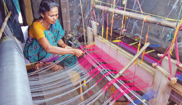 Woman working a hand loom