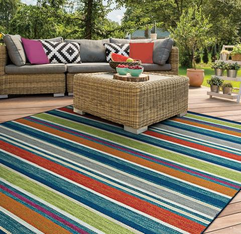 Indoor/outdoor area rug on patio seating area.