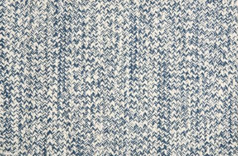Indoor/outdoor carpeting blue in braded pattern.