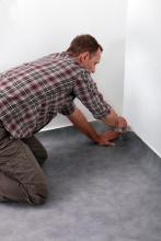 Carpet installer repairing carpet installation