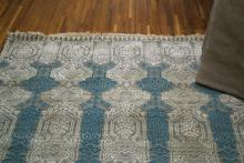 Rug in blue with a decorative stipped pattern
