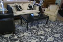 Black, white and gray rug with furniture