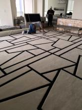 Final installation of custom fabricated rug