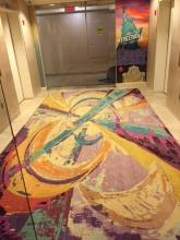 Colorful custom made rug in elevator lobby