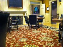 Russet rug with floral pattern with furniture