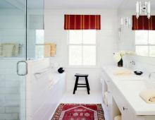 Red rug in a white bathroom