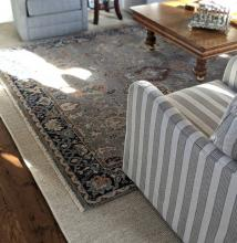 Hand-knotted layered on seagrass rug.
