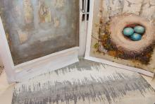 Gray and white rug with paintings