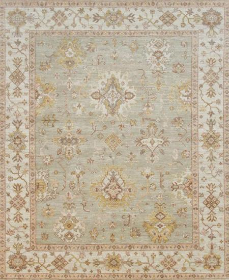 Light blue hand-knotted area rug with traditional pattern.