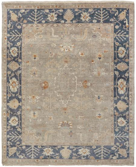 Hand-knotted area rug with traditional border.