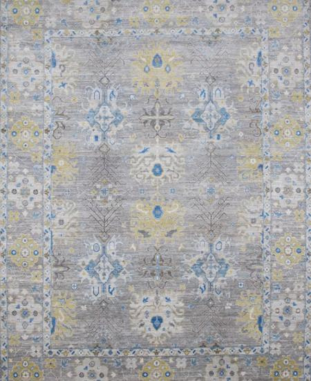 Traditional hand-knotted area rug with bright blue accents.